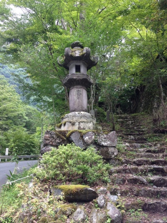 A stone lantern at the head of the trail.